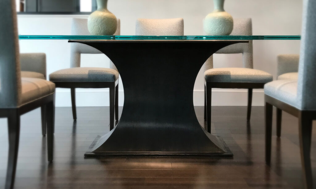 Side view of anvil table base with glass top