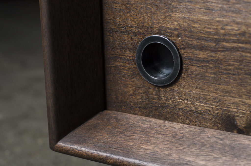 Close-up of front media console door and custom pull
