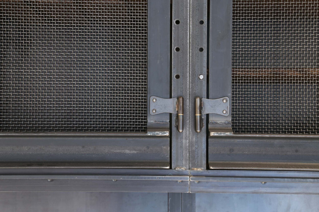 Close-up of Hauberk mesh steel cabinet fronts