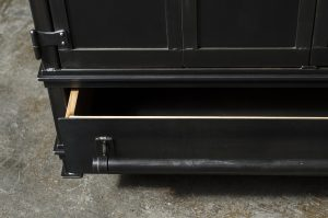 Open steel drawer with ash wood interior