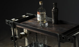Walnut bar cart top with liquor bottle and glass