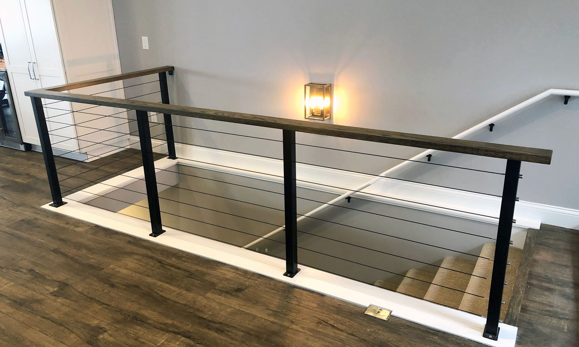Contemporary traditional staircase with custom-built railing