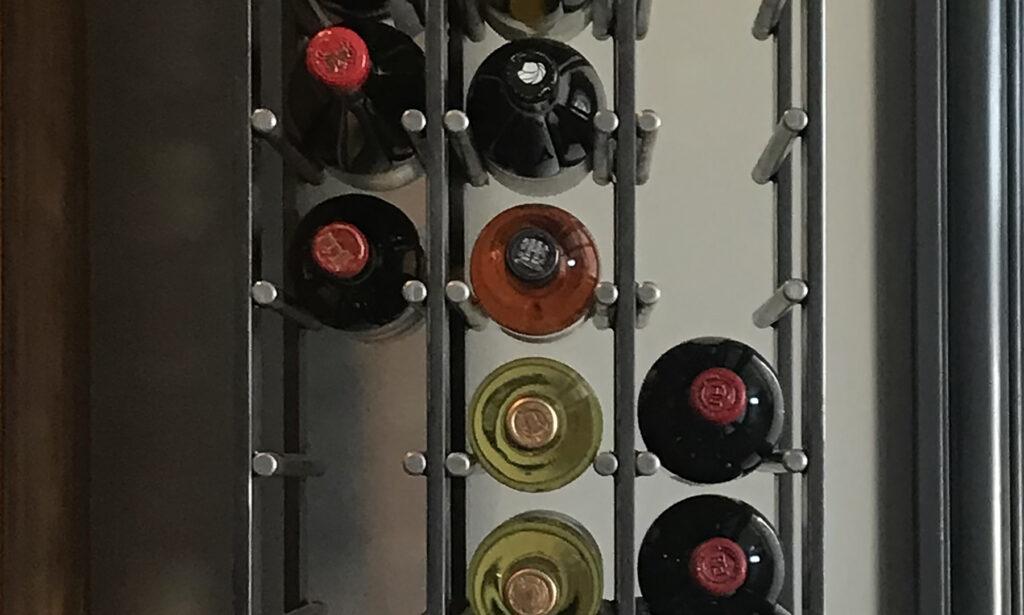 Wine bottles placed in rack