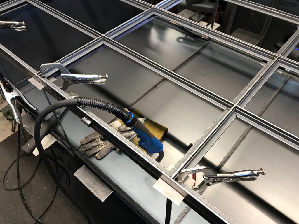 Ornamental steel door framing being fabricated