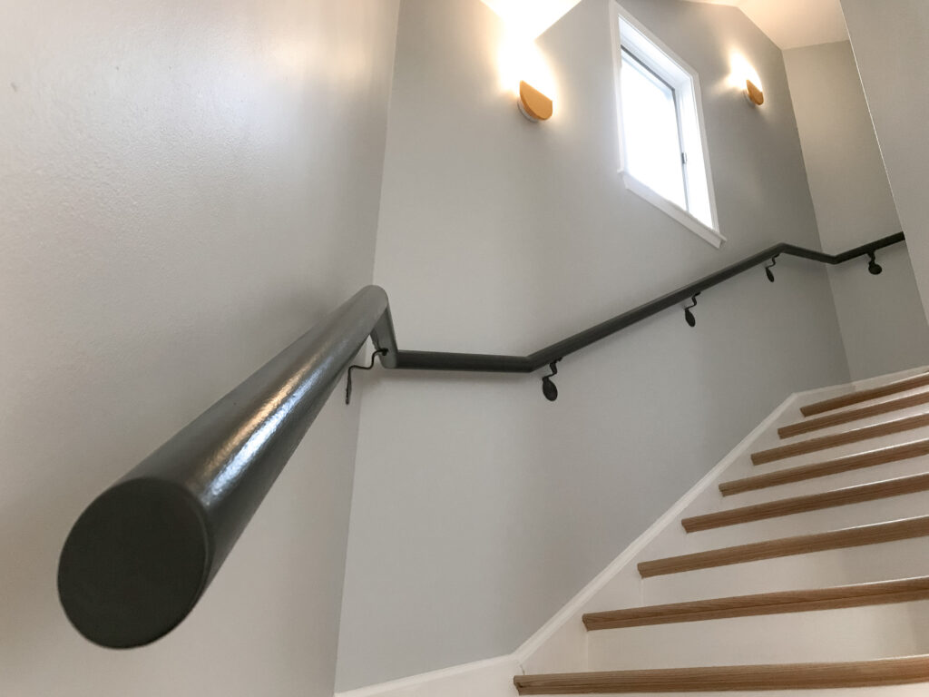 Staircase with painted steel handrail