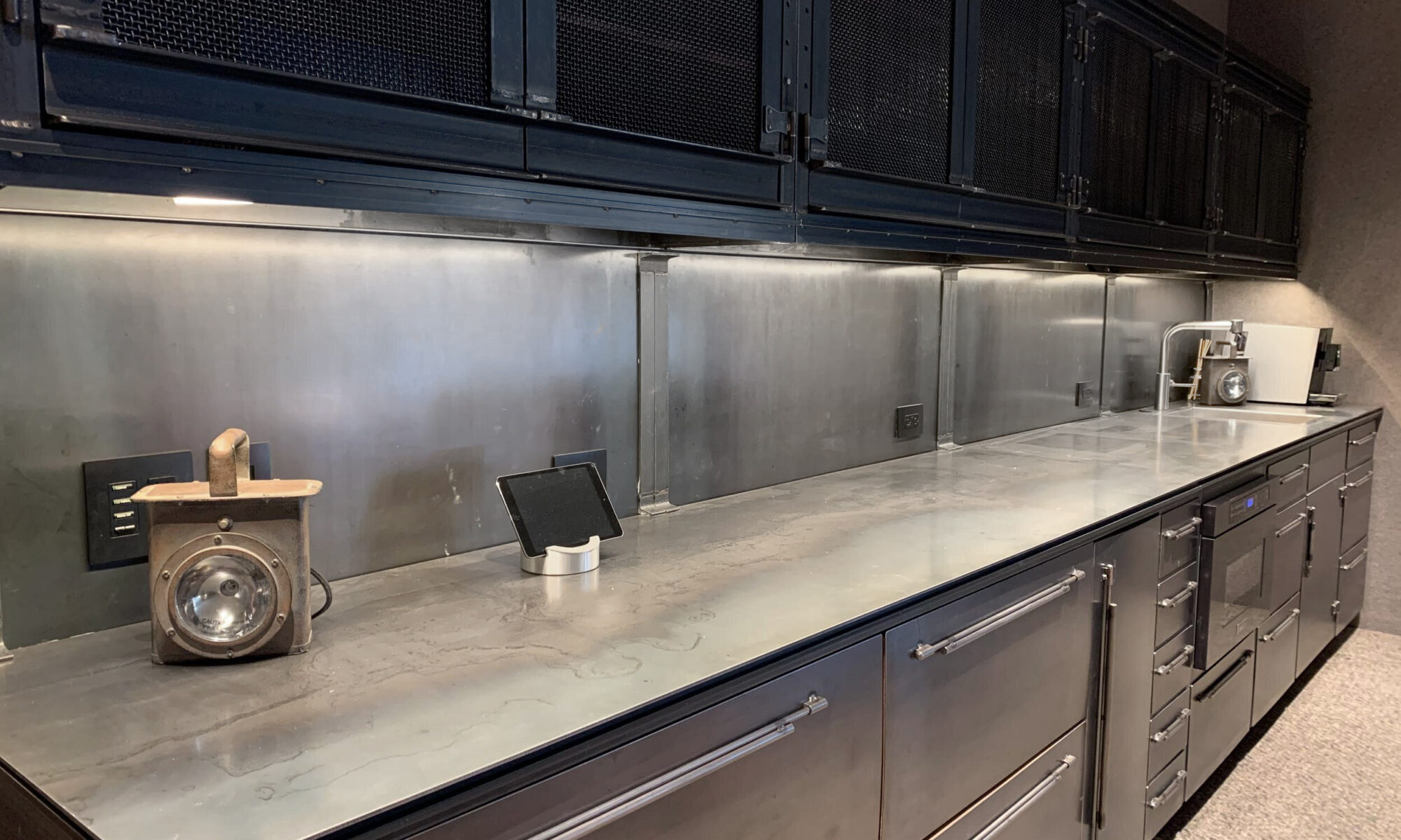 All-steel custom bar with drawers and a sink